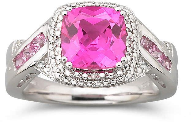 Fine Jewelry Oval Genuine Pink Sapphire and 1/6 CT. T.W. Diamond Crossover Ring G6x3VC8