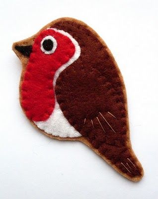 bugs and fishes blog are busy making birdies from felt... love...