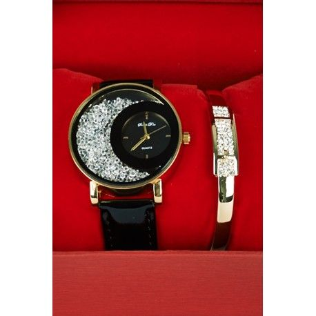 Exclusive Bracelet Gift set Watch Diamante Crystal Bead Stone Detail Leatherette Strap. Both watch and matching bracelet comes with the high quality box. Ideal gift for the Festive season, Birthdays and Anniversaries.  Key Features Include: - Diamante Design To The Face - Glass Beads Detail - Leatherette Strap - Large Numbers - Stainless Steel Back Material: - Synthetic and Metal Measurements: - 3.8 cm Diameter