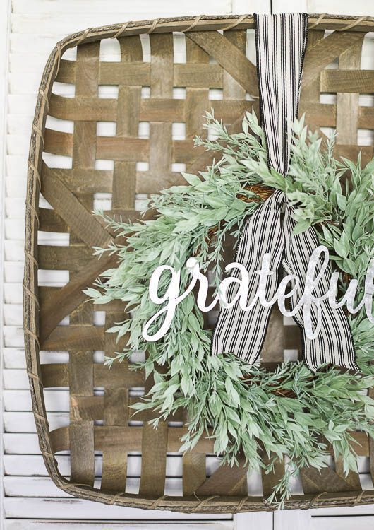 Gorgeous farmhouse style fall wreath. I love the mix of neutral greenery and galvanized metal on the tobacco basket. Click for complete source list. #falldecor #fallwreath #wreaths #wreathtutorial #style #shopping #styles #outfit #pretty #girl #girls #beauty #beautiful #me #cute #stylish #photooftheday #swag #dress #shoes #diy #design #fashion #homedecor
