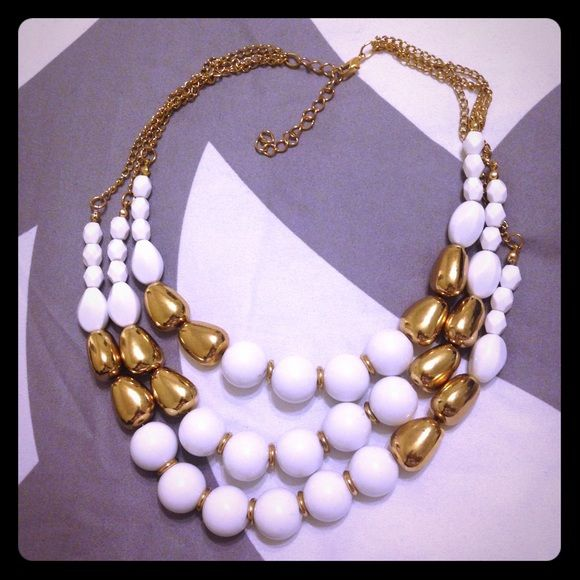 White & Gold Tiered Necklace Get ready for the all white parties this year with this white & gold necklace! Adjustable clasp with extra space to wear close to neck or longer. Worn once and like new. Jewelry Necklaces