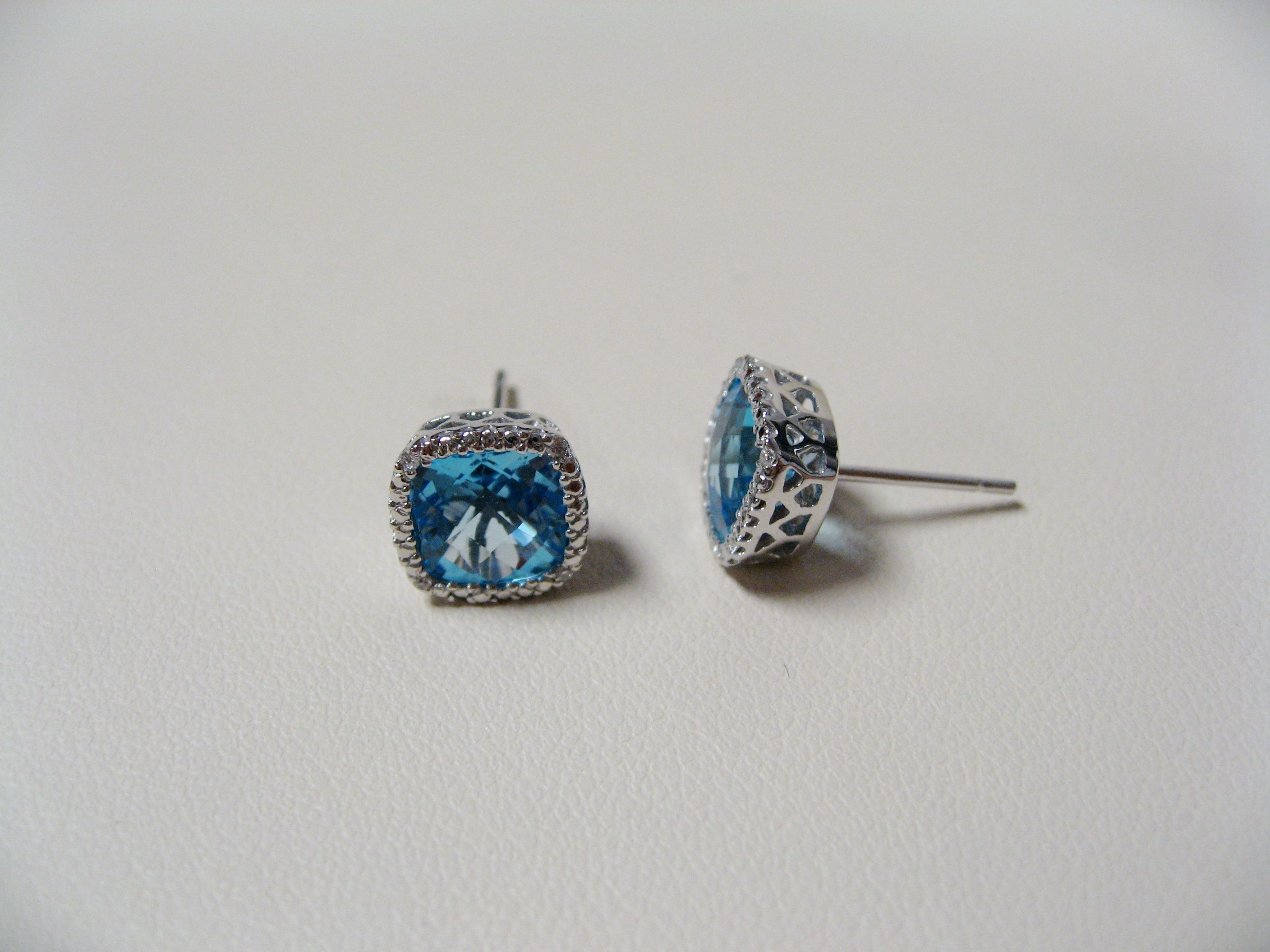 14KW Swiss Blue Earrings with 7mm stones and 4 diamonds in each.