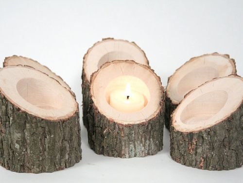 Tree branch candleholders. Would be cool as a table center piece on a dark summer night!