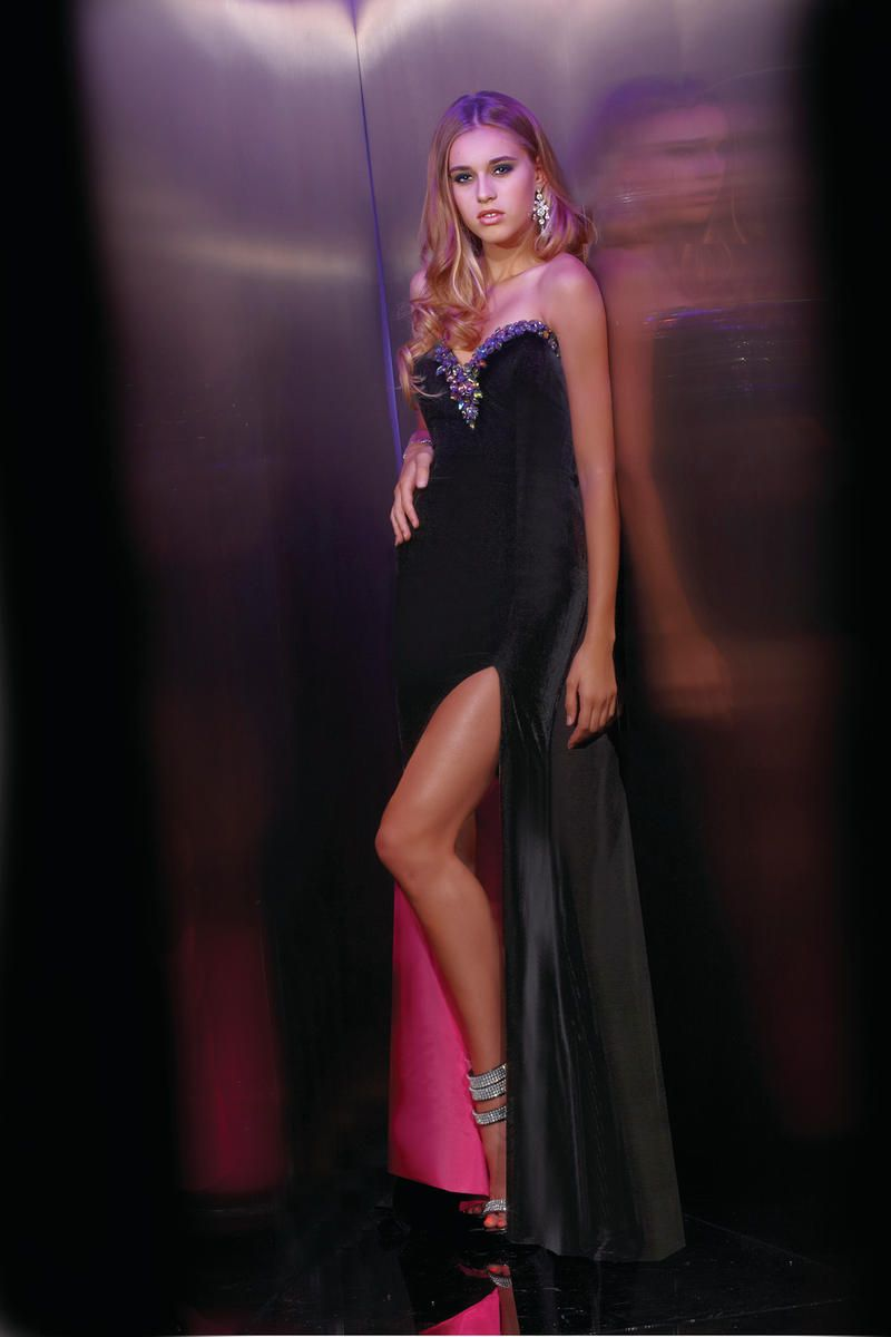 Black velvet with fuchsia lining....if only I was 22 and a size 2 ...