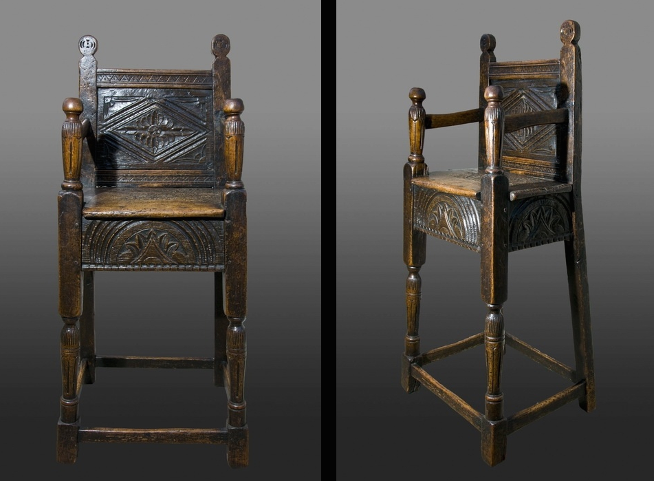 A late Elizabethan oak and fruitwood child's high chair. Carved fruitwood back panel with lozenge and leafy spandrels, seat rails carved with a single large lunette.  The same chair is also pictured in Tobias Jellinek book, Early British Chairs and Seats 1500 to 1700.