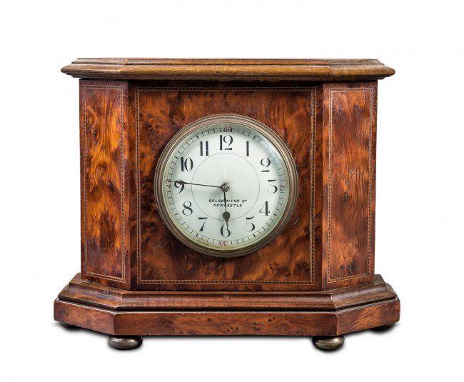 A string inlaid birdseye maple mantel clock,