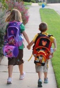 My favorite picture of Grace & Caden headed to school - first day for Caden; big sister leading way - 2008