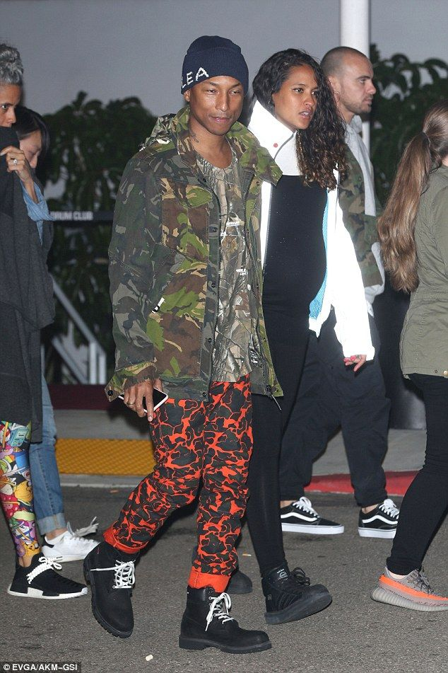 Pharrell Williams' pregnant wife Helen Lasichanh shows off baby bump