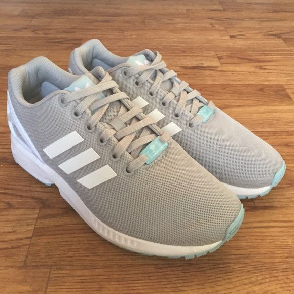 57ea9aae2fff9 ... inexpensive a pair of womens adidas zx flux shoes. dominating color is  gray with white