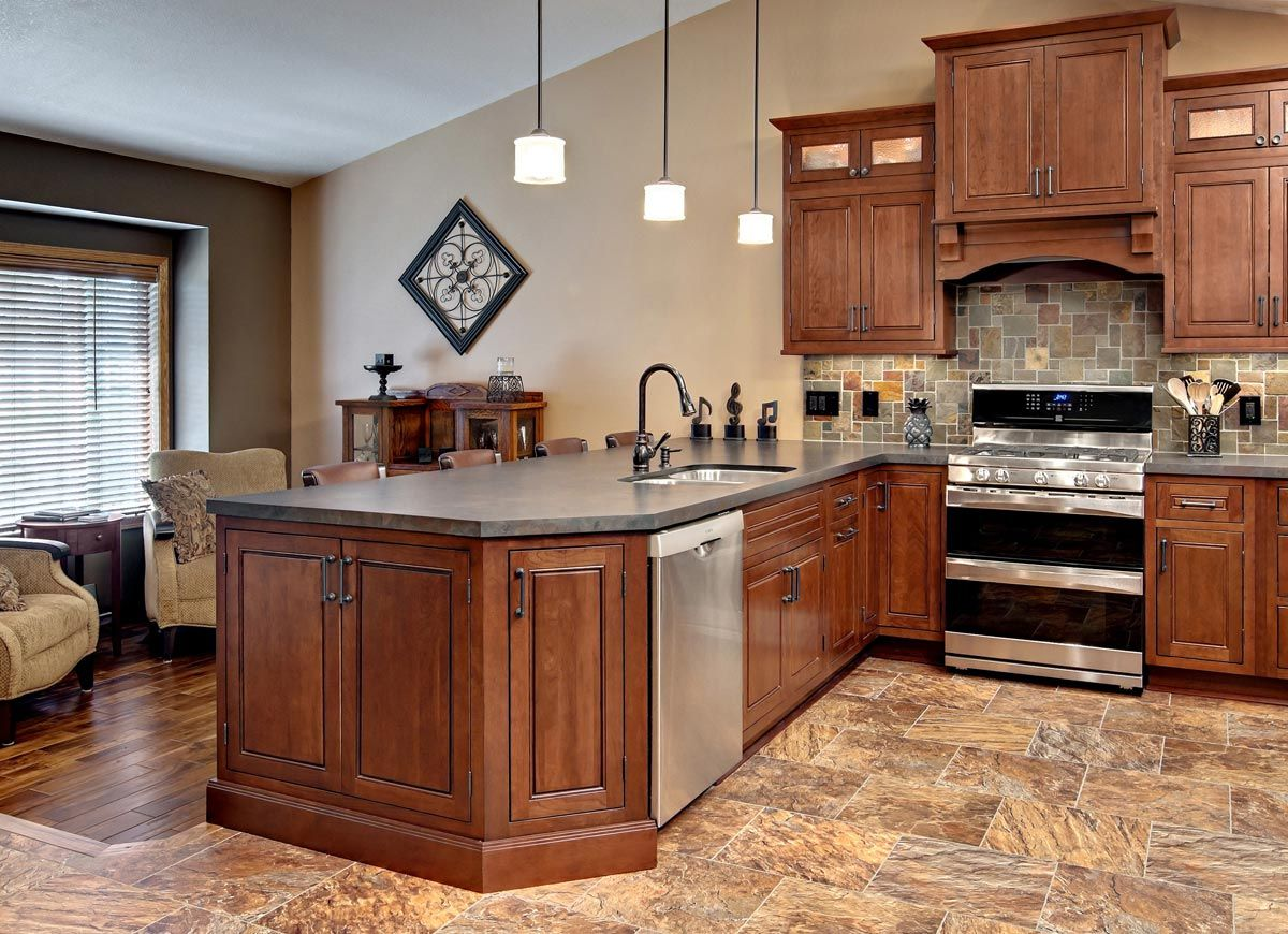 minnesota peninsula kitchen has cherry cabinets in a traditional