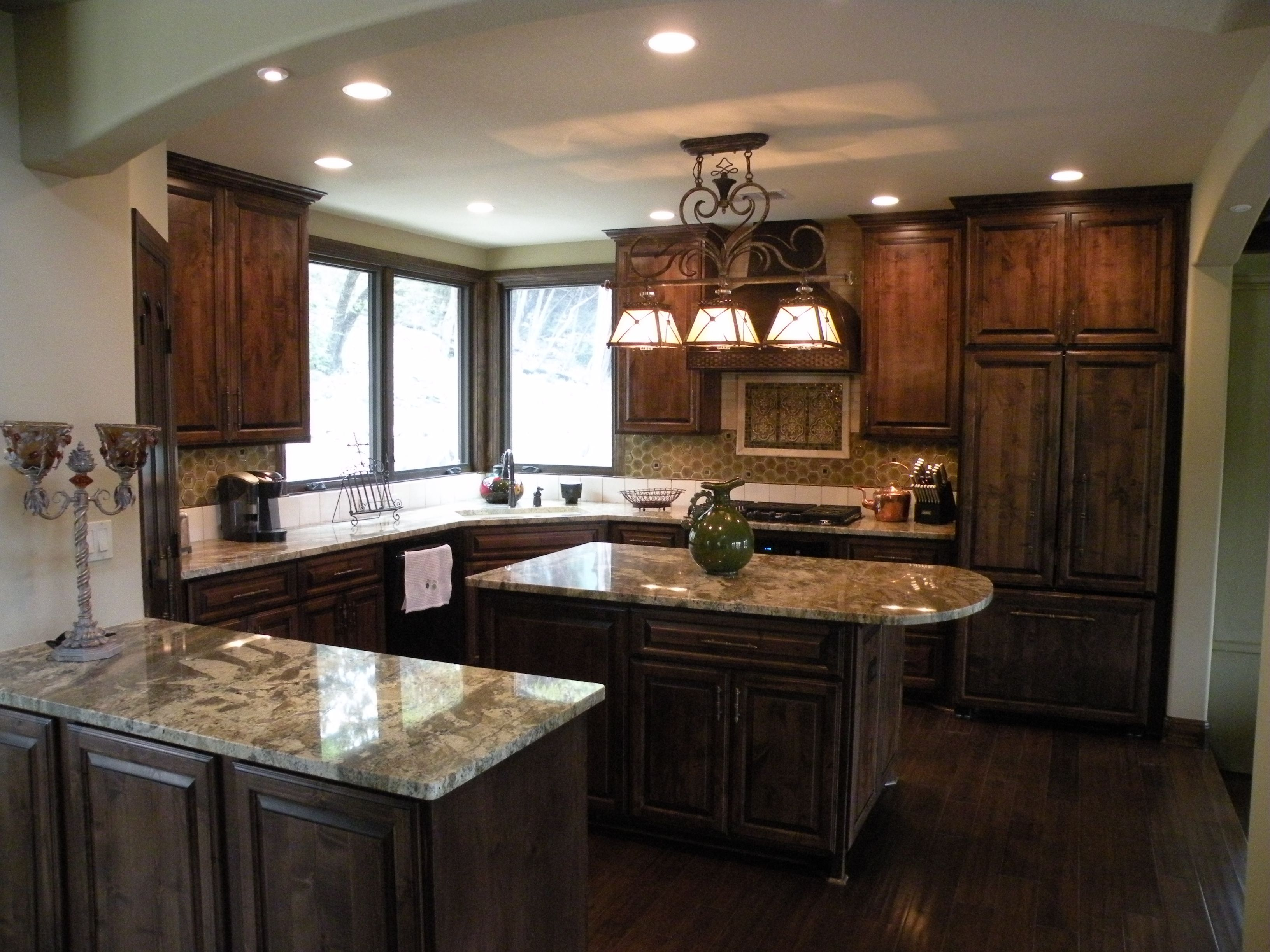 Very comfortable kitchen layout cabinets are knotty alder for Kitchen paint colors with dark wood cabinets