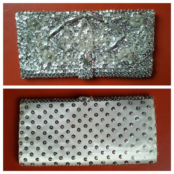 Check out this item in my Etsy shop https://www.etsy.com/listing/257701131/vintage-silver-satin-clutch-sequins
