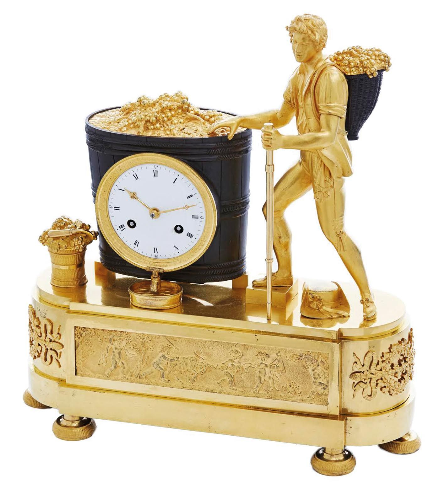 French Empire, circa 1810, bronze and ormolu mantel clock depicting the grape harvest, the movement set in the wine hat.