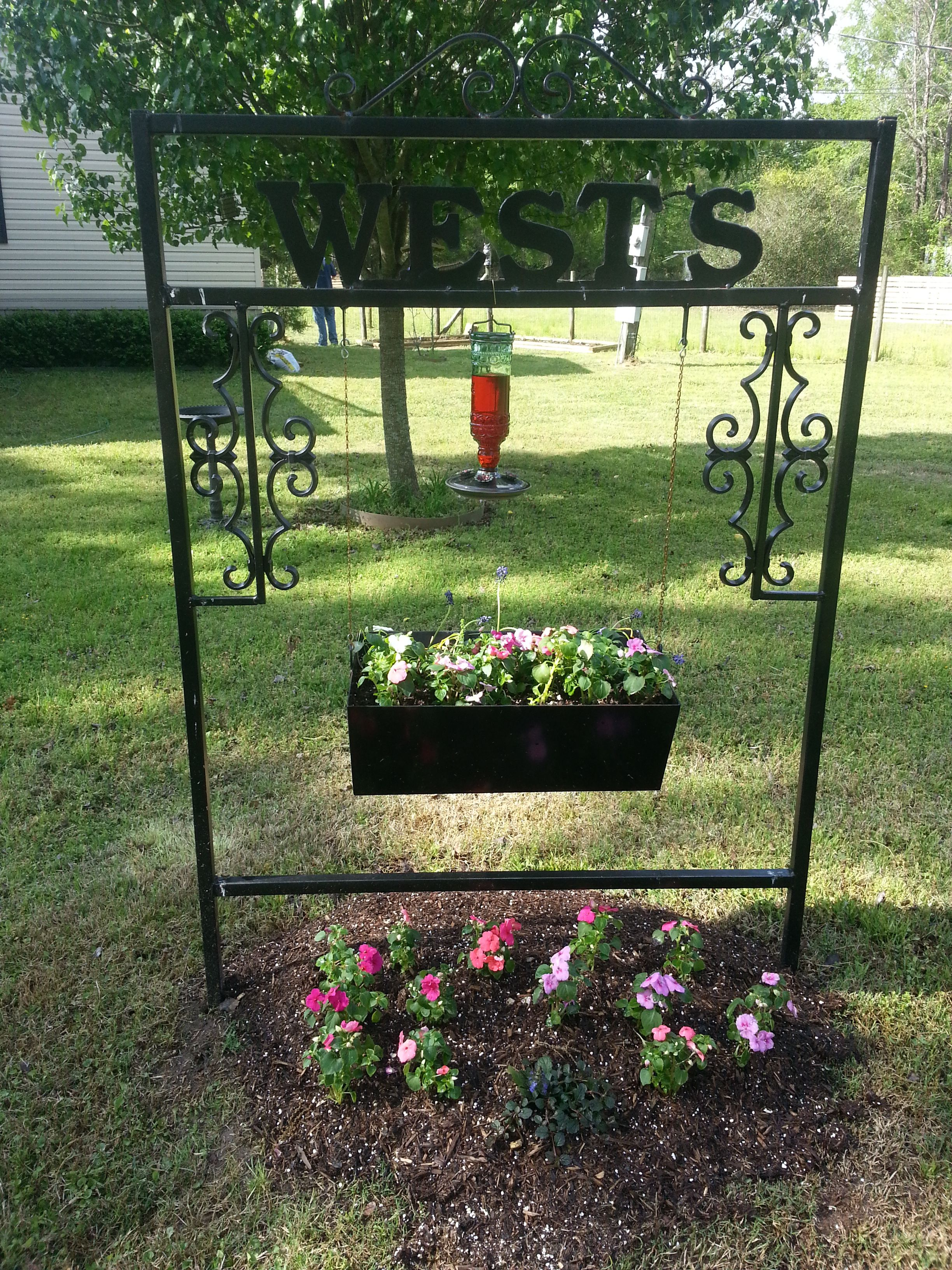 Wrought Iron Yard Sign With Family Name On It