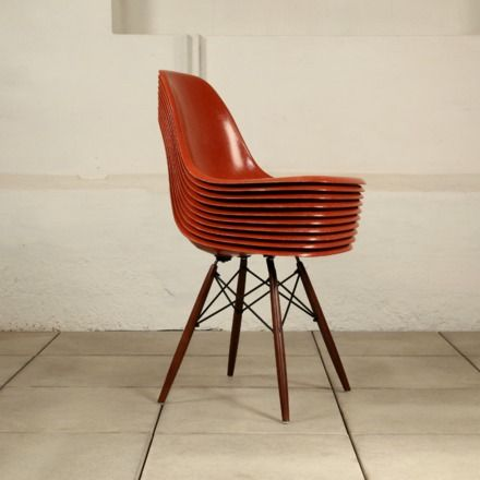 1960s Rare Eames DSW Chairs in Terracotta. Cliche 'classic design reproduction' but beautiful original colour, really goes with the scheme. From Vintage Seekers