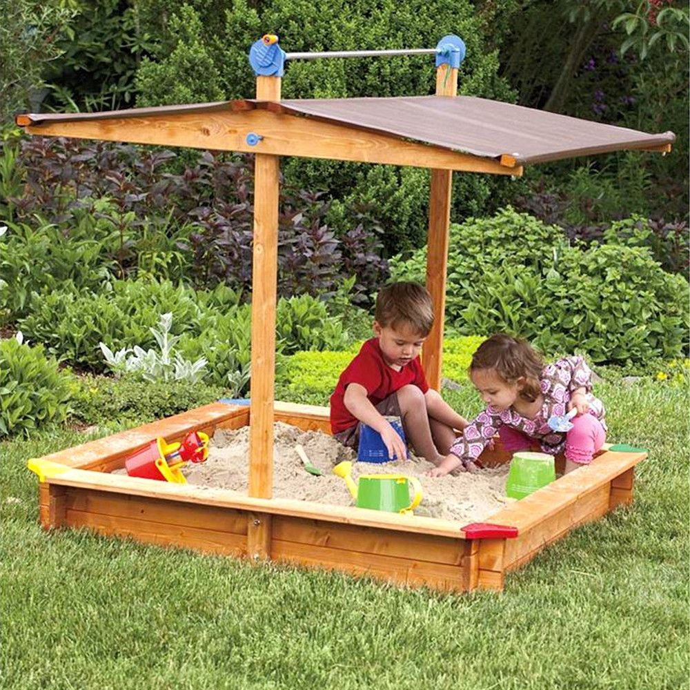 covered kids entertainment area with sandbox chalkboard and