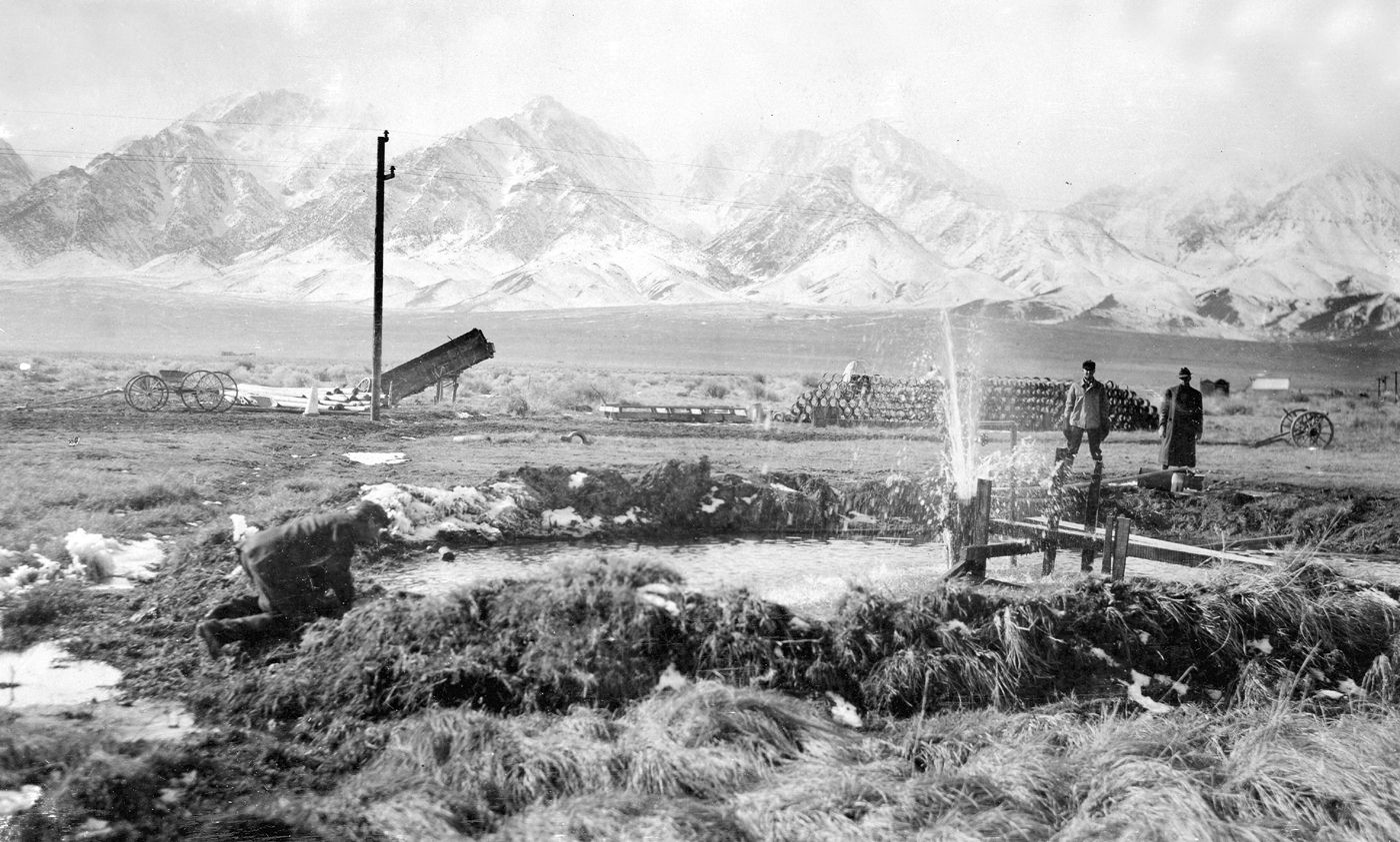 Flowing well belonging to the City of Los Angeles near Independence, Owens Valley. Inyo County, California. 1910.