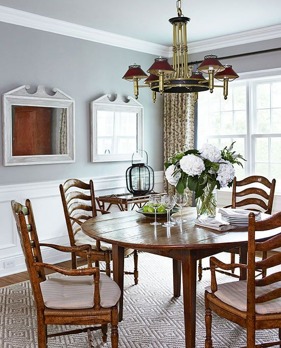 cottage style homes: an antique dining table welcome guests to the