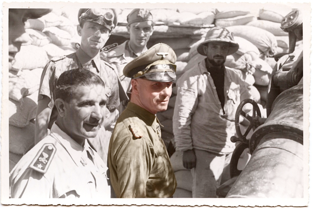 A partial colourisation of General der Panzertruppe Erwin Rommel visiting Italian gun emplacements in the area of Tobruk during September 1941.