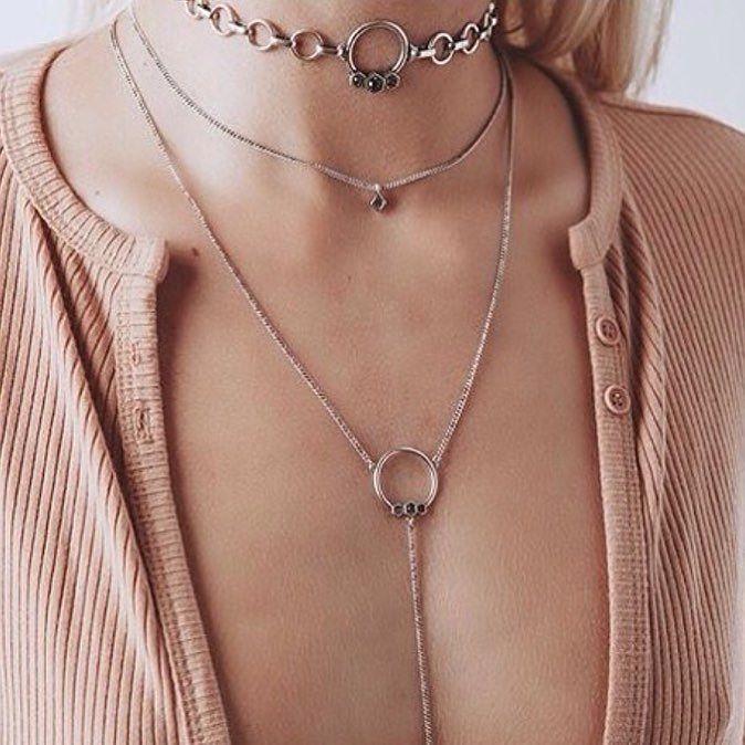 A true lesson in layering from Luv AJ Made in LA sito love you can shop this look from @jewelcitizen the curated  fashion jewellery shop for super cult designer brands. #luvaj#layering#layerednecklace#layeredjeweller#chains#romantic#spring#fblogger#fashionjewellery#modernjewellery#lastyle#geometric