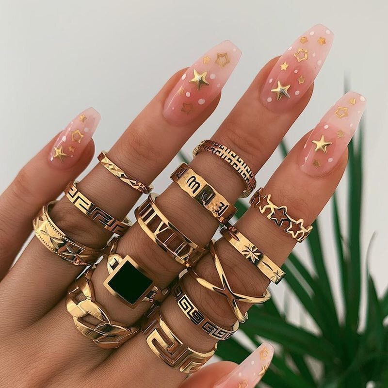 Style: Punk, ExaggerateType: Ring SetColor: GoldWeight: About 39.5gSize: As the picture showsMaterial: AlloyQuantity: 13 pcsPackage Includes:1 X Ring Set