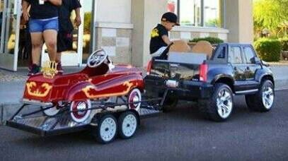 I can't stand it! A Junior Car SUV pulling a four- wheel trailer with a custom pedal show car! Too cute!