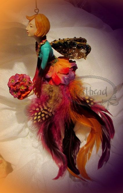 Perltrend.A new addition to my growing collection of Carnival feather Gisela Graham angels.So beautiful.