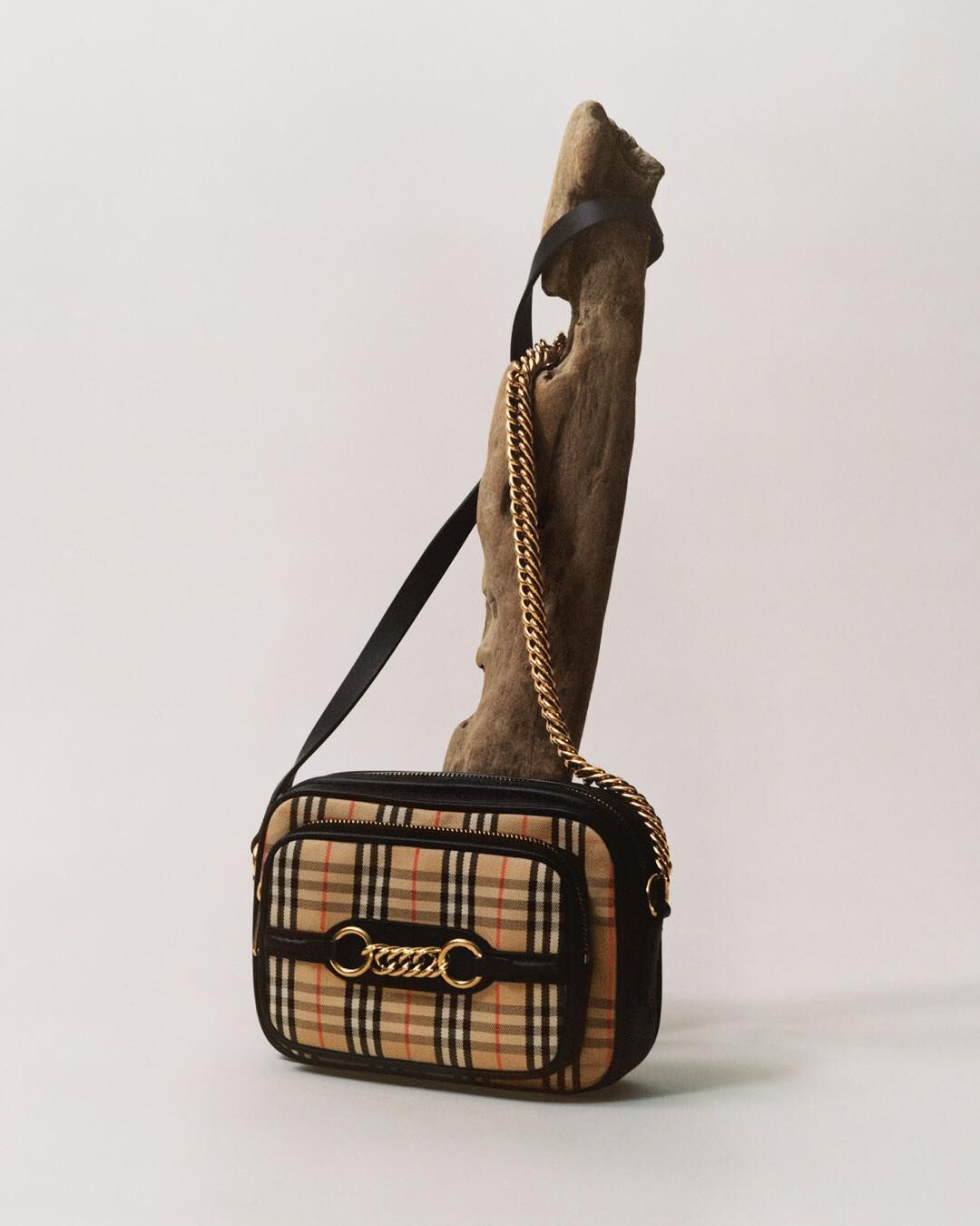 """f672290590ca Burberry on Instagram  """"GRAPHIC LINES . The Link Camera Bag in 1983 check .  Photographed by  LaurenceEllis"""""""