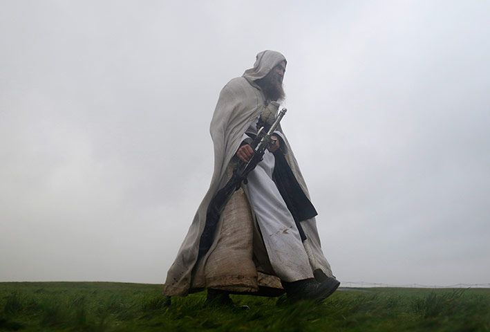 Credit: Kieran Doherty/Reuters The druid Merlin walks towards the stones to start the celebrations of the winter solstice at Stonehenge, in ...