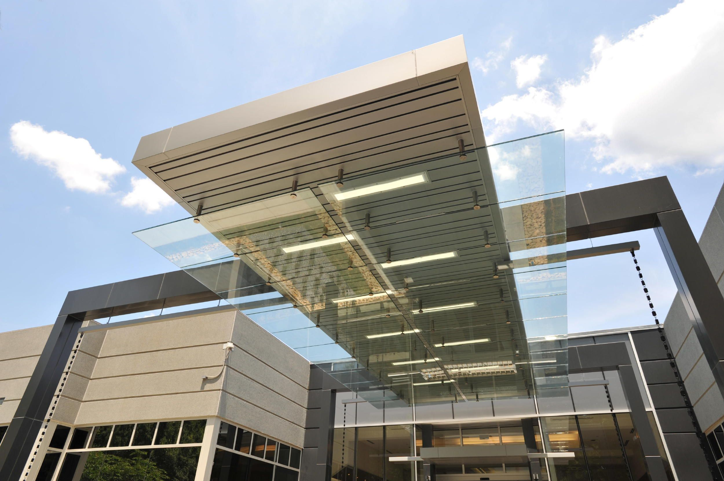Commercial building entrance canopies design of novelis for Modern business buildings