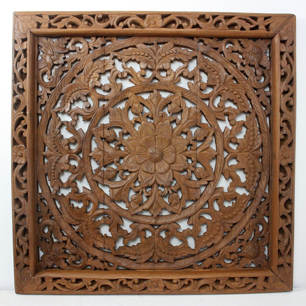 This remarkably handcarved wall panel showcases an intricately