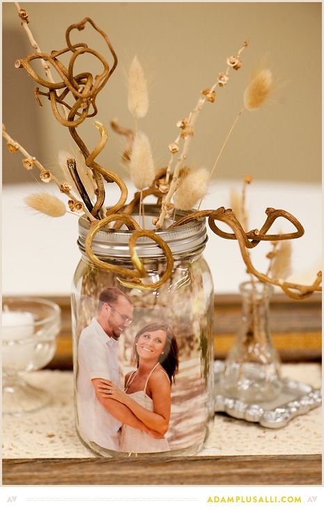 Use mason jars as picture frames for your centerpieces