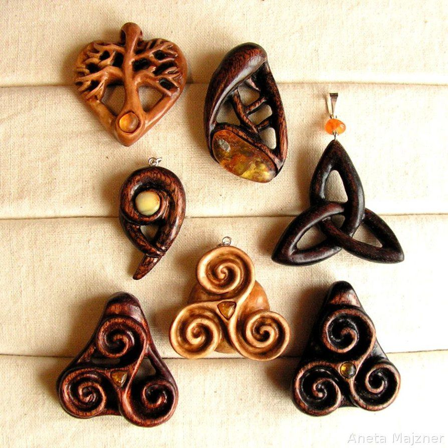 Triskelion triquetra wooden pendants with amber by ambersculpture triskelion triquetra wooden pendants with amber aloadofball Image collections
