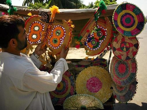 Arranging Traditional Hand Fans Along The Main Road Fans