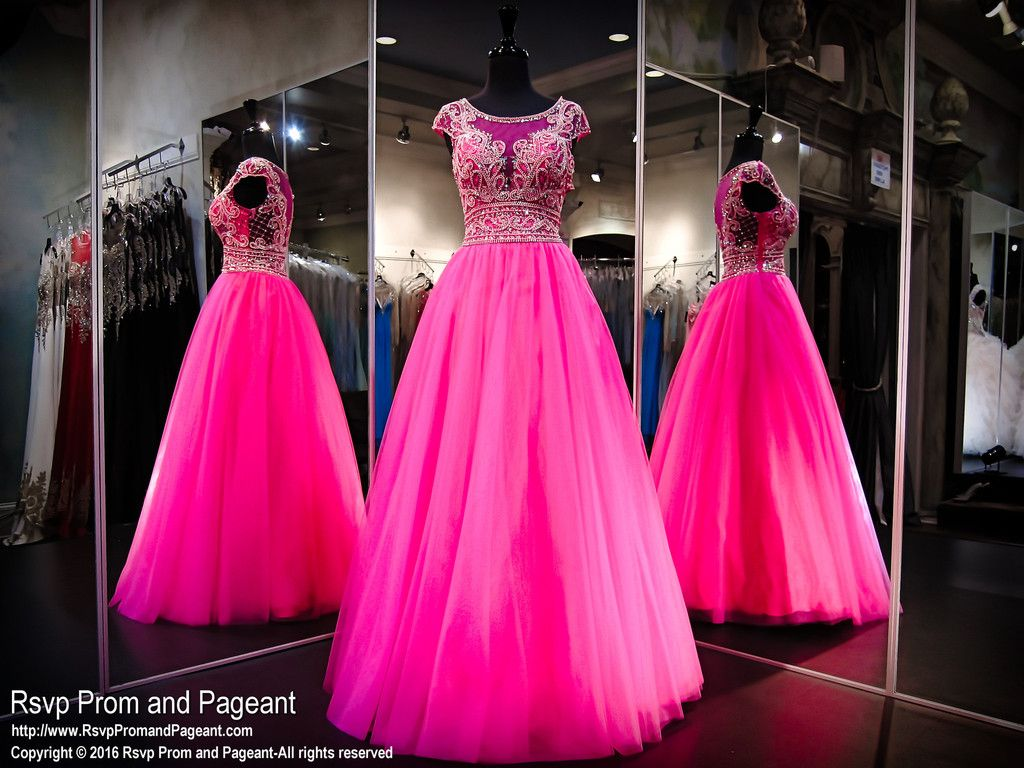 Be the queen at the ball in this fabulous pink ball gown. Its high ...