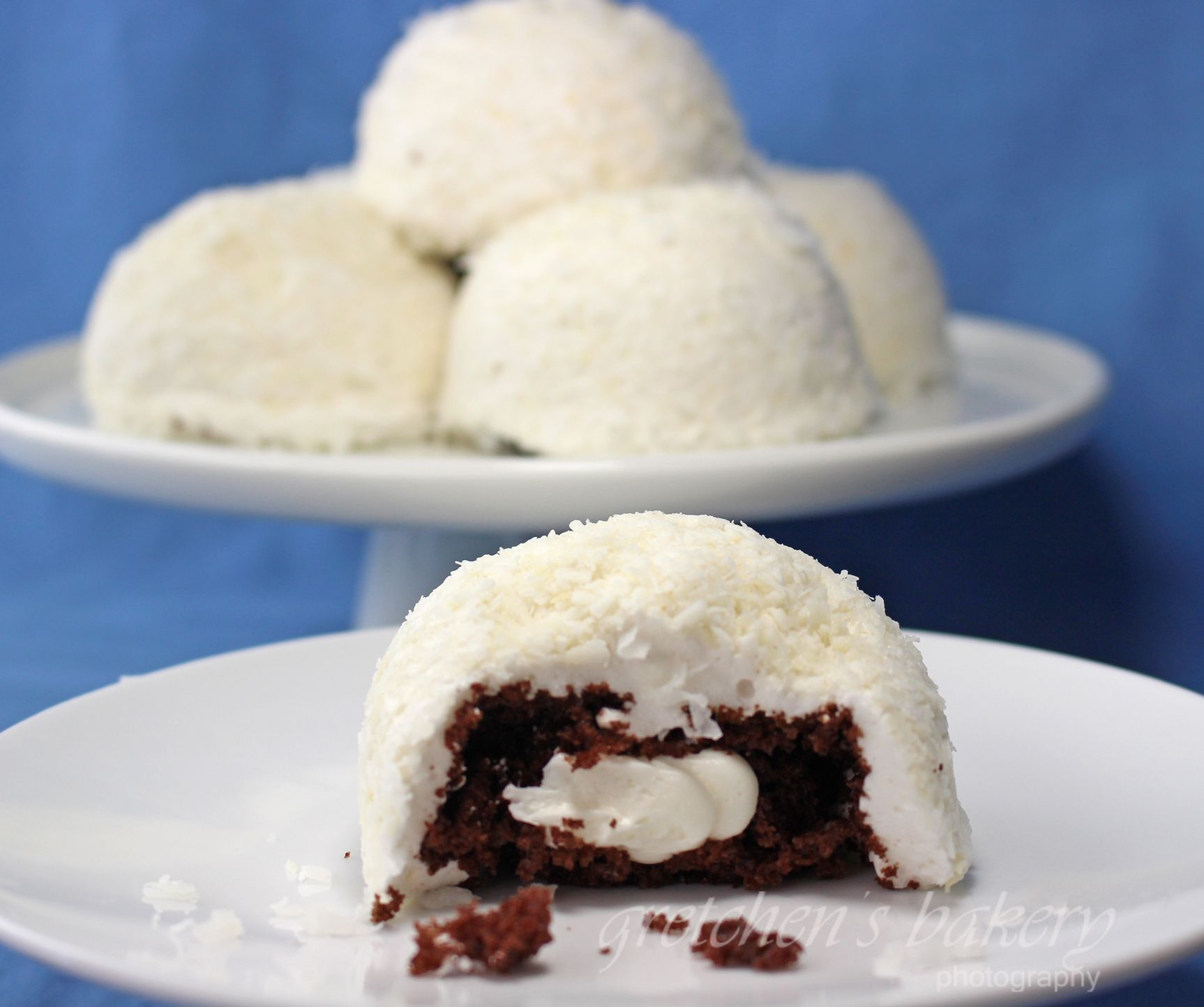 Sno Balls Copy Cat Recipe is better than the real thing! Chocolate cake stuffed with buttercream and covered in marshmallow & coconut!