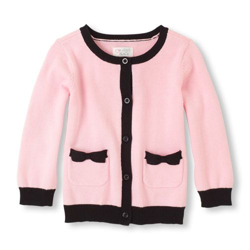 Pretty bows and contrast trim make for a sweet cardigan style! Very Chanel!