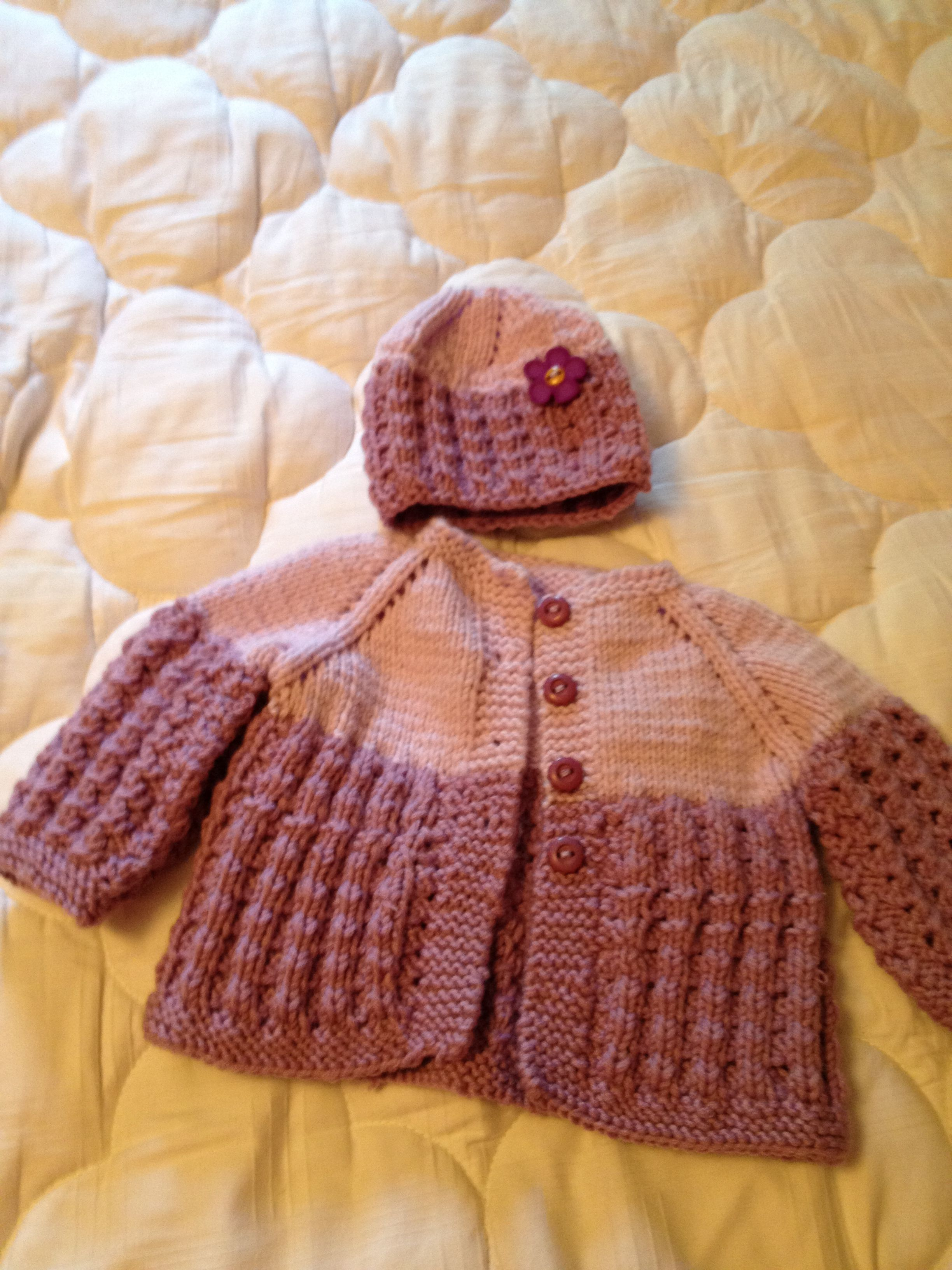 Matching sweater and hat made for new baby.