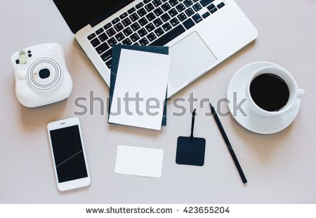 Creative flat lay photo of workspace desk with laptop, blank card, coffee, tag…
