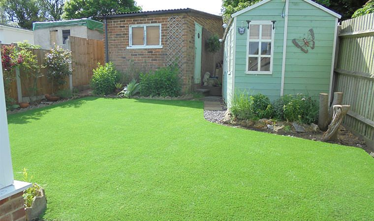 A lovely back garden lawn in Maidstone, Kent fitted with