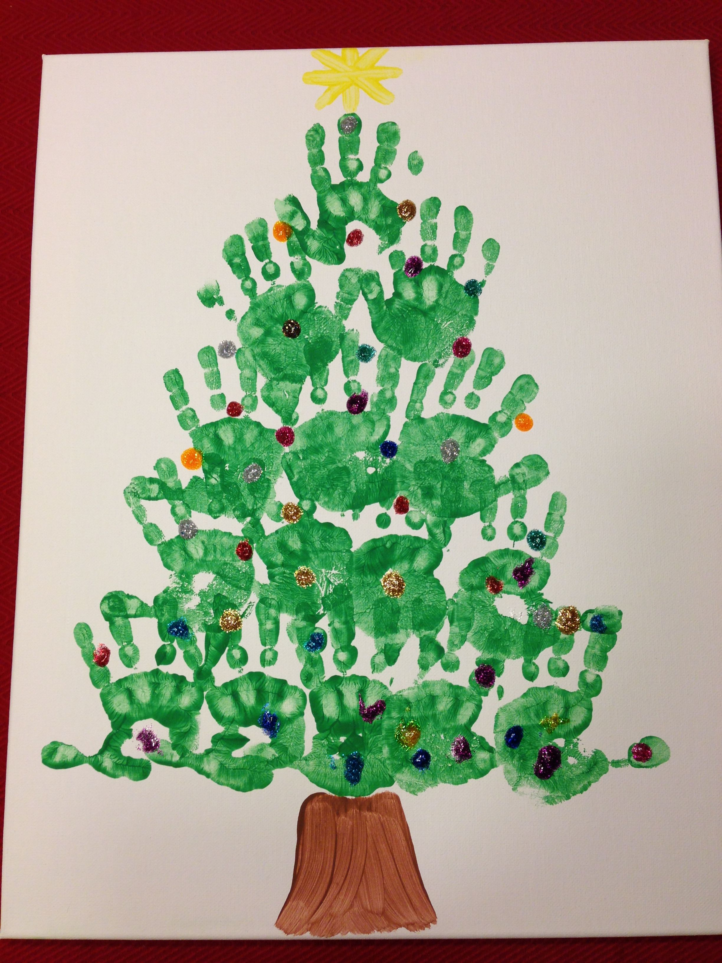 Handprint Christmas Tree With Glitter Glue Ornaments Lights Diy Christmas Tree Christmas Tree Crafts Handprint Christmas Tree