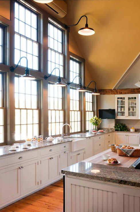 stunning kitchen with honey colored cathedral ceiling over a wall of sash windows lit by on kitchen decor over sink id=18287