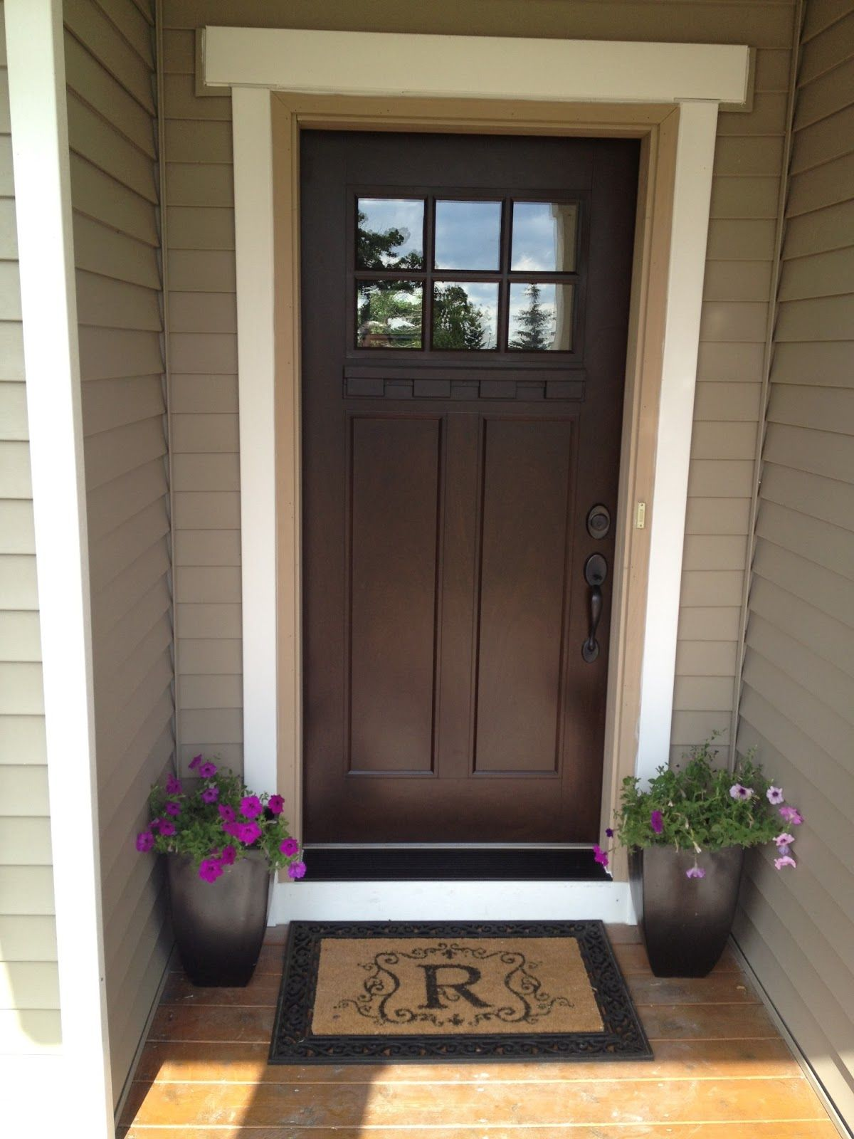 We can paint our front door chestnut and then add a new screen