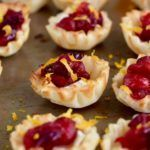 These Cranberry Brie Bites are as delicious as they are pretty! #cranberrybriebites These Cranberry Brie Bites are as delicious as they are pretty! #cranberrybriebites