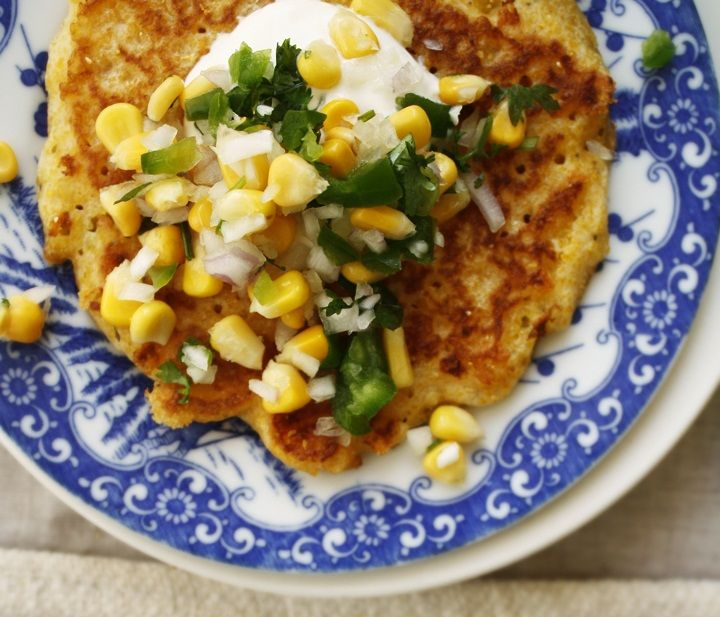 Cornmeal Pancake with Corn Salsa: Savory cornmeal cheddar pancakes make the perfect edible base for sweet and zesty corn salsa. Kids will have fun whisking the buttermilk batter together and decorating their finished pancake with spoonfuls of corn salsa and dabs of sour cream. #KidsCookMonday