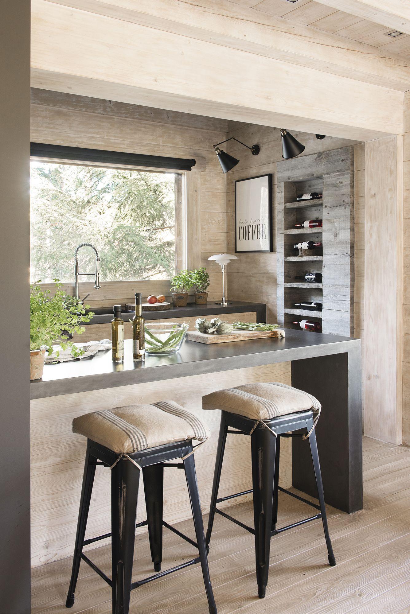 Una cocina con barra  Maison bois, Separation cuisine salon