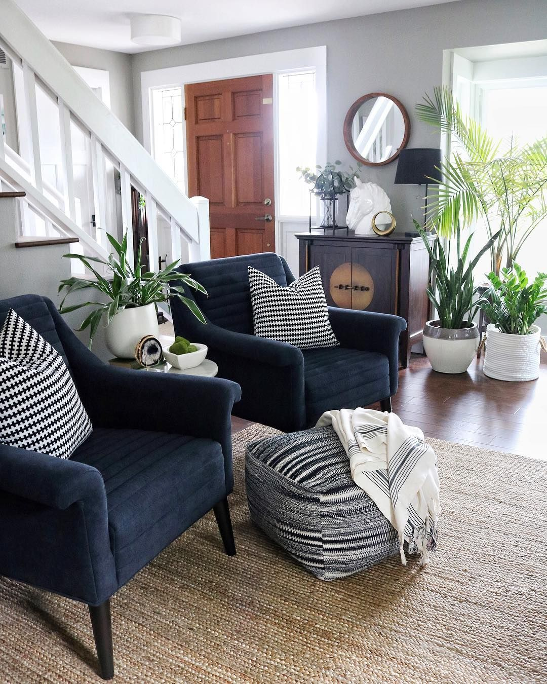 Living Room With Navy Accent Chairs Jute Rug Plant S Blue