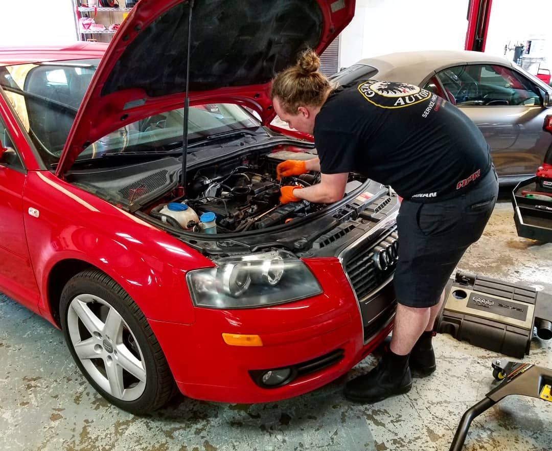 Dustin performing an oil separator update on a 2006 Audi ...