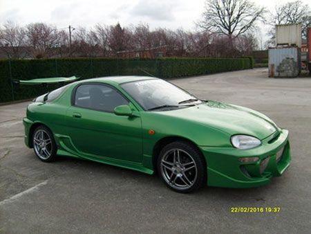 Green Mazda mx-3