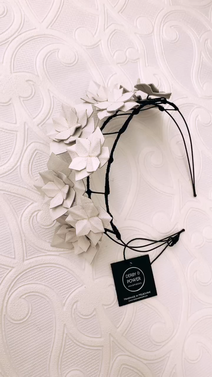 White Geometric Statement Spring Racing Hatinator Shop handmade leather fascinators and headpieces that are perfect for Derby Day! The black & white theme might be one of the most classic race days, but you are sure to look truly unique in a Derby & Power headpiece! Featured here is 'Marscay' from the Florence Collection.